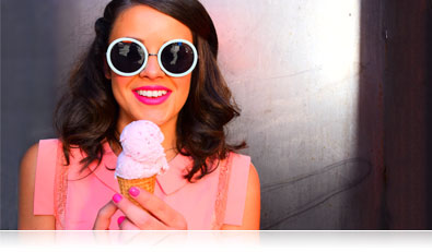 D5500 photo of a woman in big sunglasses eating ice cream