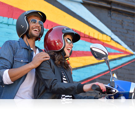D5500 photo of a woman and man on a motorcycle smiling