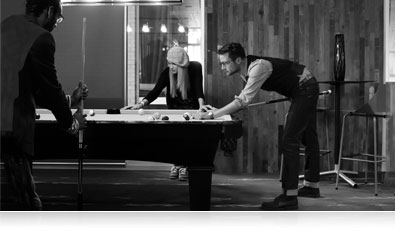D5500 photo of three people playing pool, shot in B&W, highlighting Picture Controls