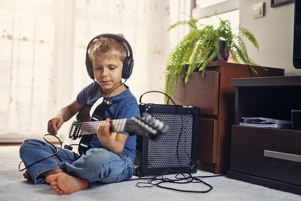 Boy Electric Guitar At Home